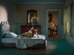 1940s bedroom scene with a nude woman lying on bed. u.s.A