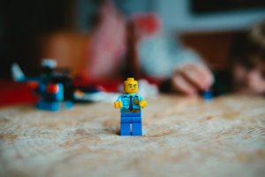 lego mini figure on brown wooden table