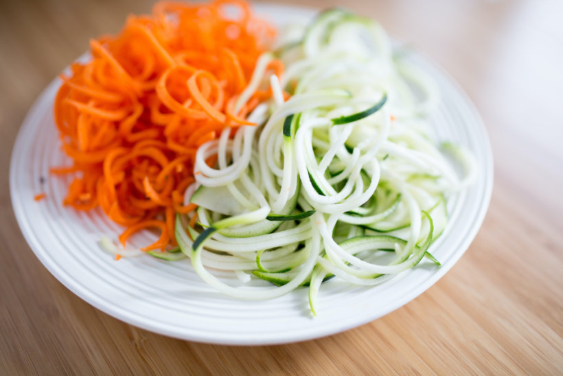 round white ceramic plate with sliced vegetables